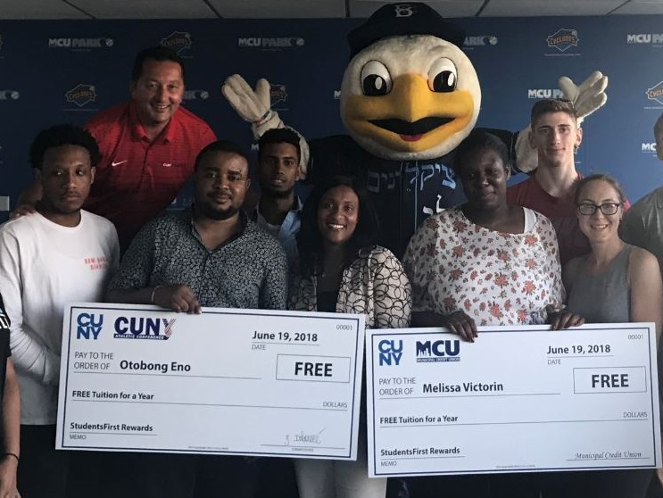 MCU Assistant Vice President of Business Development Trisha Guy (center) congratulates CUNY students Otobong Eno and Melissa Victorin on being named the 2017-2018 StudentsFirst Rewards Scholarship Winners at MCU Park in Coney Island on Tuesday, June 19, 2018.