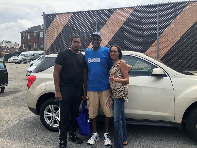 MCU member Marla Scurry and her family pose with their new car, purchased with an MCU Auto Loan during the MCU and Enterprise Car Sales lot sale at East Elmhurst, NY on Saturday, August 18th.