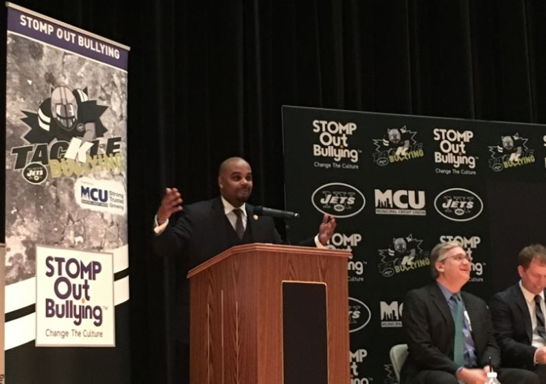 MCU Vice President of Business Development/Member Relations Corey Fernandes addresses more than 400 students and educators at the STOMP Out Bullying school recognition event at Queens Metropolitan High School on Tuesday, February 13, 2018. Throughout the winter and fall of 2017, MCU partnered and worked closely with the New York Jets and STOMP Out Bullying to empower youth through the Jets Upstander of the Week Program.