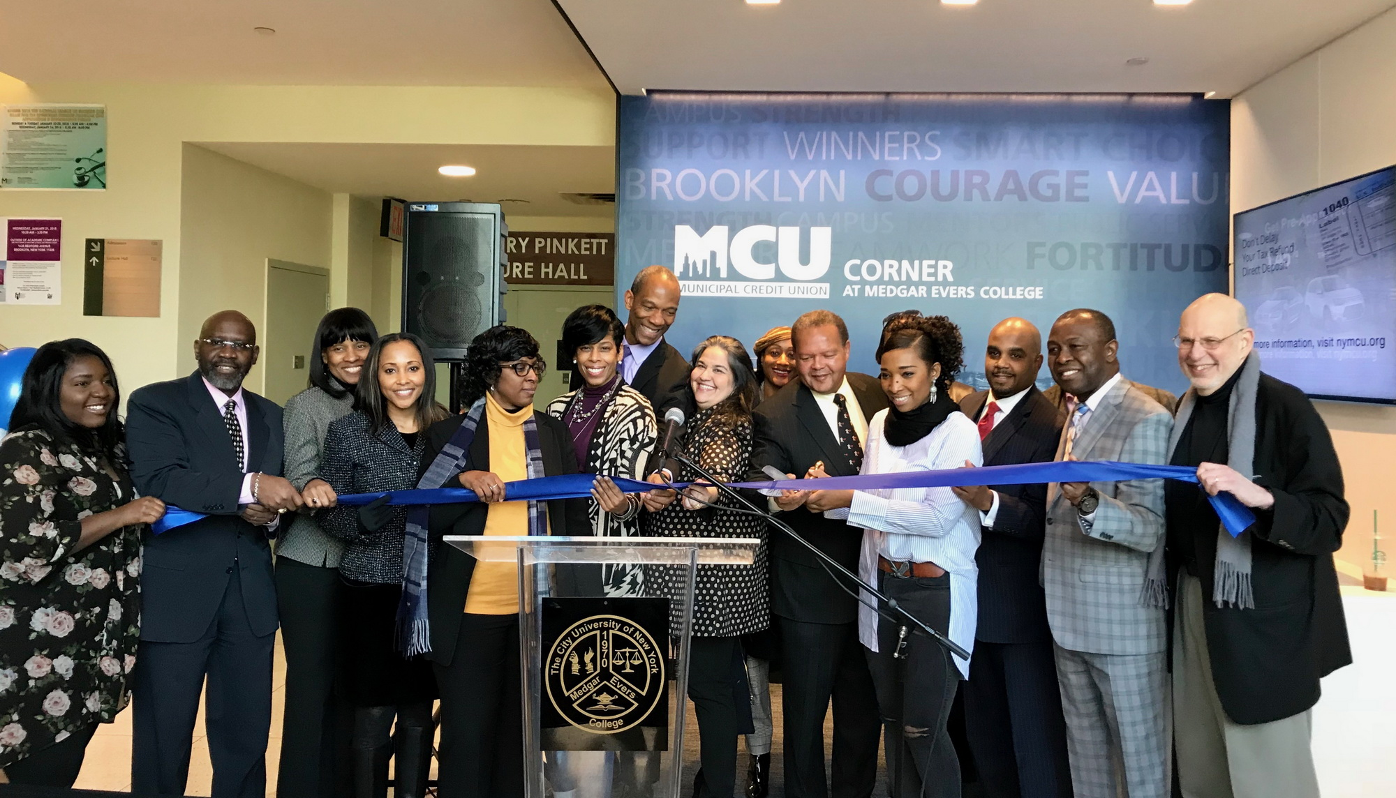 Representatives from Medgar Evers College and Municipal Credit Union cut the ribbon on the new MCU Corner at Medgar Evers College, an interactive banking center designed to provide banking service to the campus community while also serving as a tech-forward common area for students and faculty.